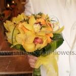 Νυφική Ανθοδέσμη Στρογγυλή με Ορχιδέες και Τριαντάφυλλα σε πορτοκαλί αποχρώσεις